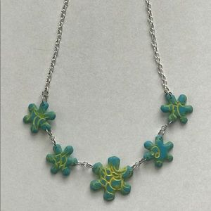 Jewelry - Green and yellow flower shaped necklace.